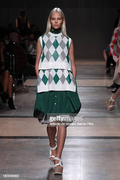 A model walks the runway during Sacai show as part of the Paris Fashion Week Womenswear Spring/Summer 2014 on September 30 2013 in Paris France