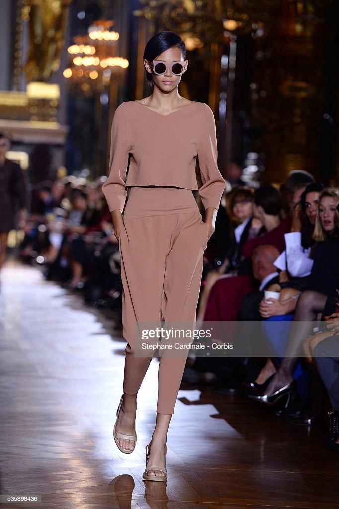 A model walks the runway during Stella McCartney show, as part of the Paris Fashion Week Womenswear Spring/Summer 2014, in Paris.
