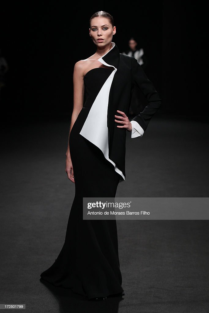 A model walks the runway during Stephane Rolland show as part of Paris Fashion Week Haute-Couture Fall/Winter 2013-2014 at Tennis Club de Paris on July 2, 2013 in Paris, France.