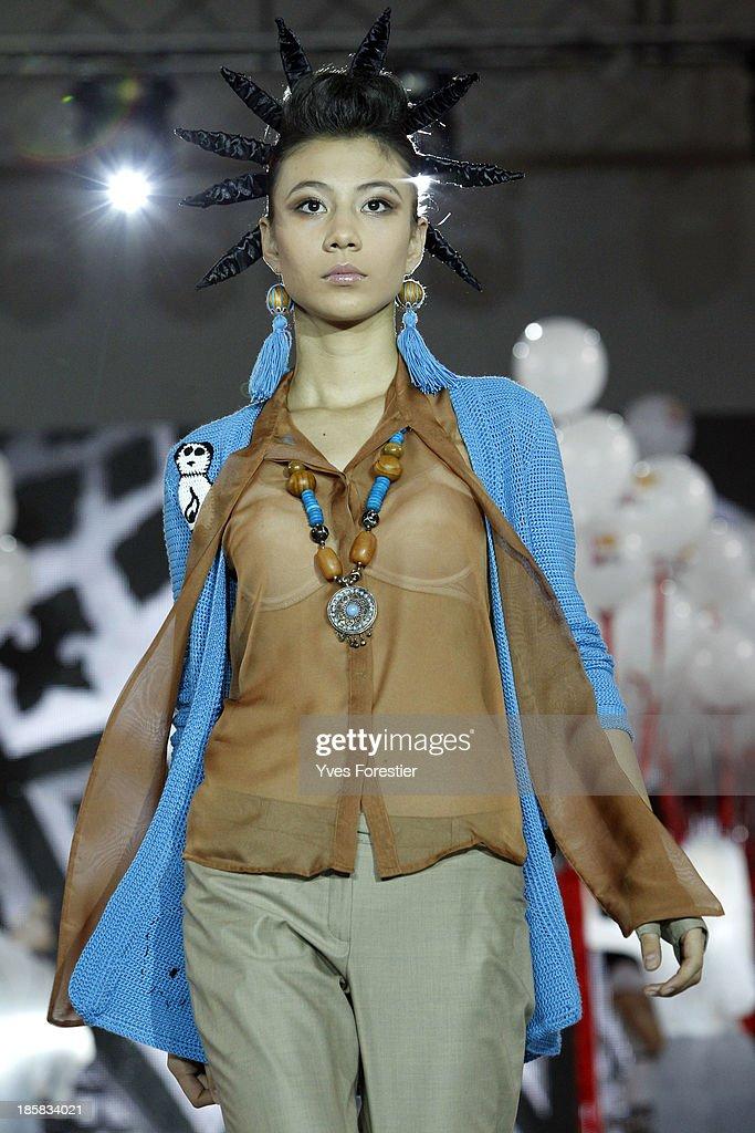 A model walks the runway during Style UZ Art Week 2013 at The Youth Art Palace on October 24, 2013 in Tashkent, Uzbekistan.