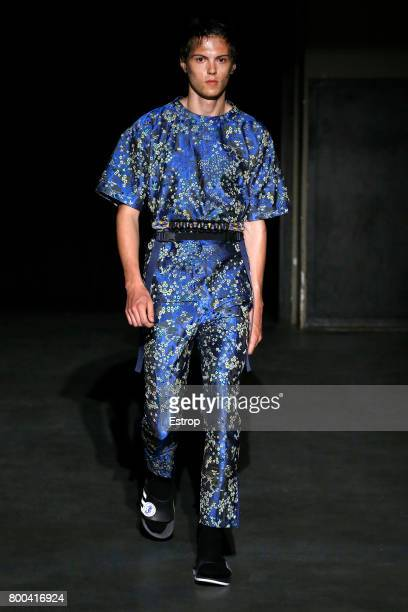 A model walks the runway during the 22/4_Hommes Menswear Spring/Summer 2018 show as part of Paris Fashion Week on June 23 2017 in Paris France