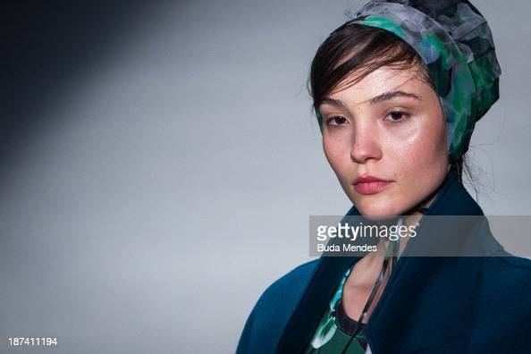 A model walks the runway during the 2nd Floor fashion show at Fashion Rio Winter 2014 at Pier Maua on November 8 2013 in Rio de Janeiro Brazil Photo...