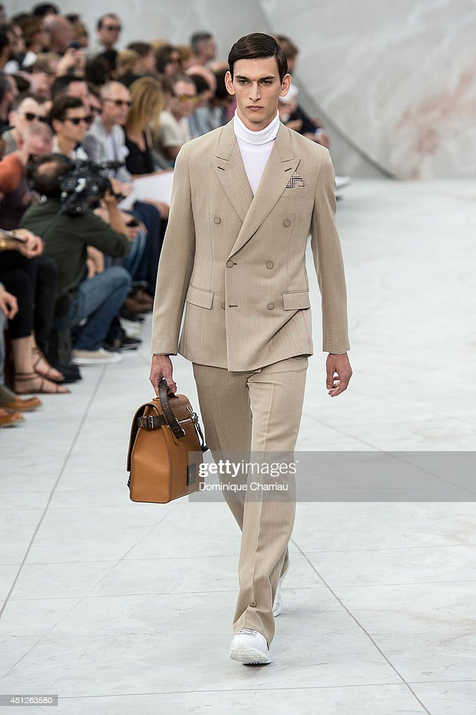 A model walks the runway during the 31 Louis Vuitton show as part of the Paris Fashion Week Menswear Spring/Summer 2015 on June 26 2014 in Paris...