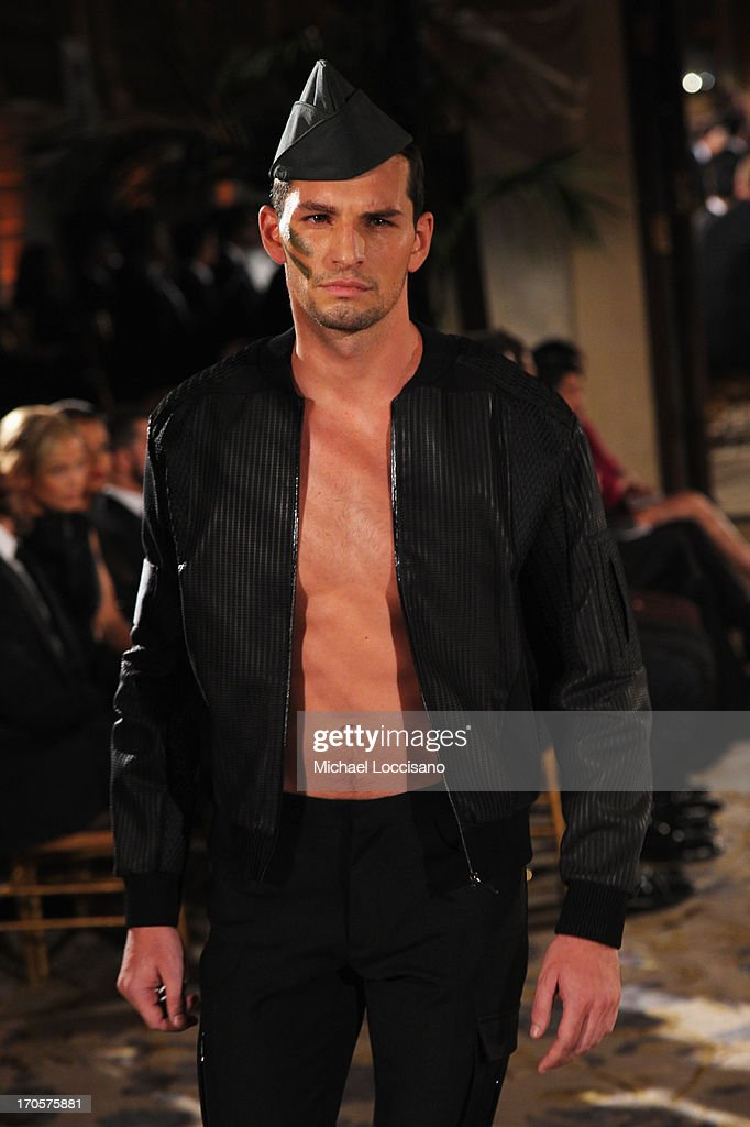 A model walks the runway during the 4th Annual amfAR Inspiration Gala New York at The Plaza Hotel on June 13, 2013 in New York City.