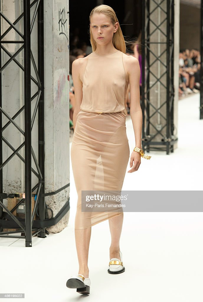 A model walks the runway during the Acne Studios show as part of the Paris Fashion Week Womenswear Spring/Summer 2015 on September 27 2014 in Paris...
