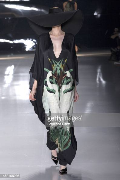 A model walks the runway during the Adriana Degreas show at Sao Paulo Fashion Week Summer 2014/2015 at Parque Candido Portinari on April 2 2014 in...