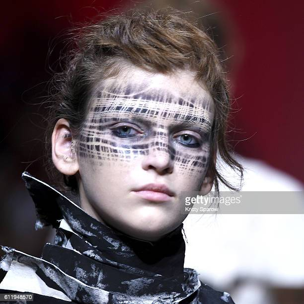 A model walks the runway during the Aganovich show as part of Paris Fashion Week Womenswear Spring/Summer 2017 on September 28 2016 in Paris France