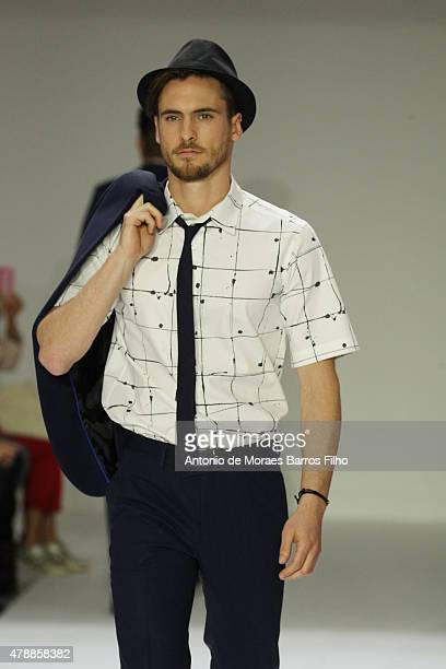 A model walks the runway during the Agnes B Menswear Spring/Summer 2016 show as part of Paris Fashion Week on June 28 2015 in Paris France