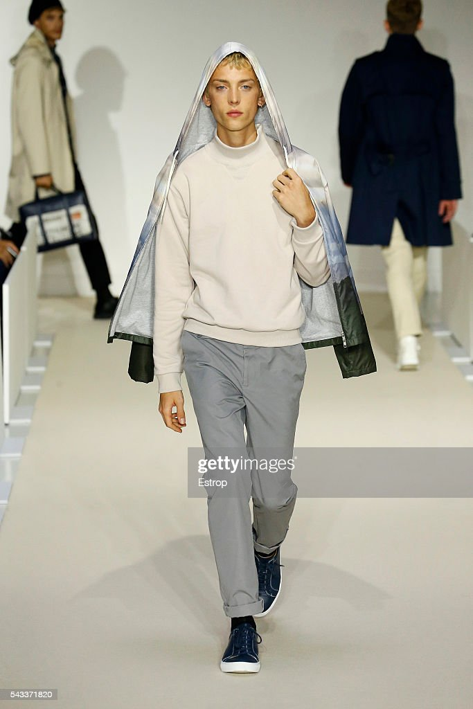 A model walks the runway during the Agnes B. Menswear Spring/Summer 2017 show designed by Agnes Trouble as part of Paris Fashion Week on June 26, 2016 in Paris, France.