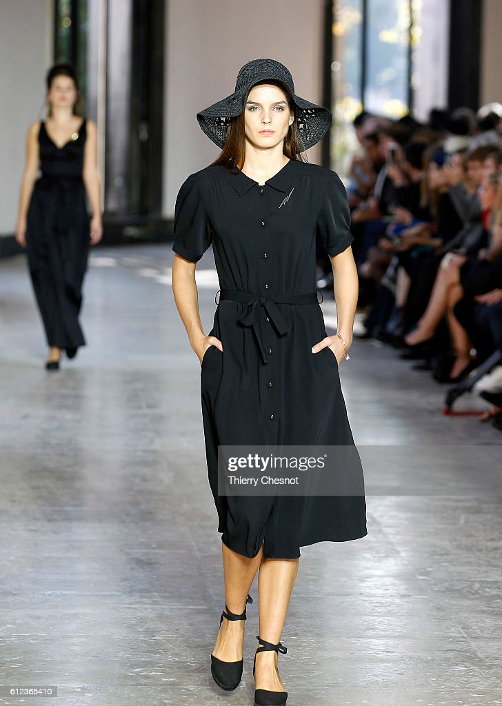 model-walks-the-runway-during-the-agnes-b-show-as-part-of-the-paris-picture-id612365410
