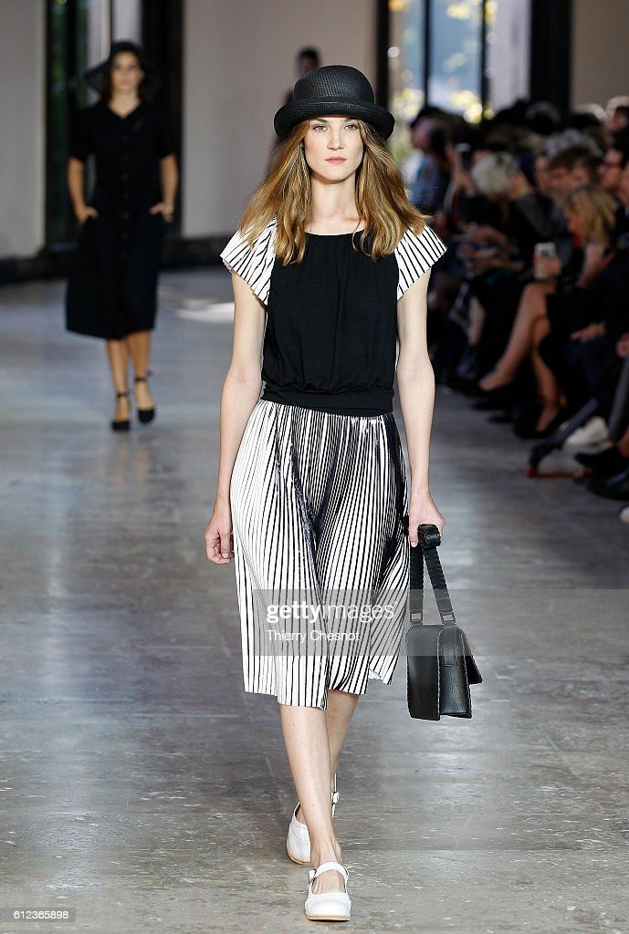 model-walks-the-runway-during-the-agnes-b-show-as-part-of-the-paris-picture-id612365898