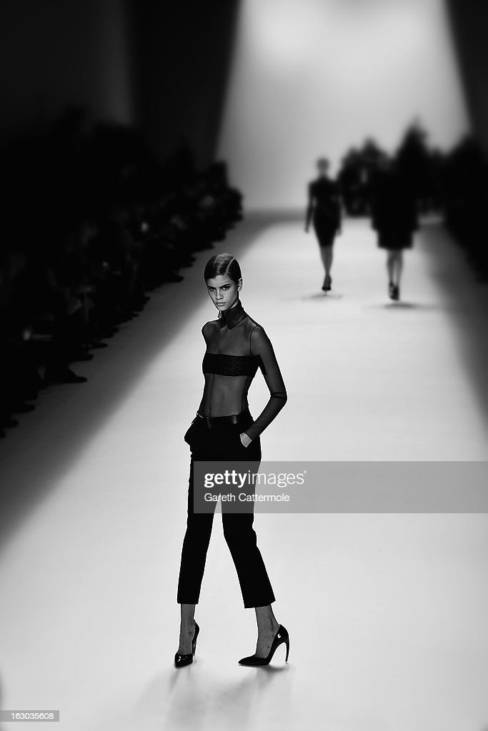 A model walks the runway during the Akris Fall/Winter 2013 Ready-to-Wear show as part of Paris Fashion Week on March 3, 2013 in Paris, France.