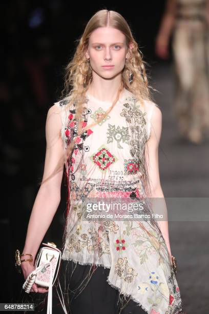 A model walks the runway during the Alexander McQueen Paris show as part of the Paris Fashion Week Womenswear Fall/Winter 2017/2018 on March 6 2017...