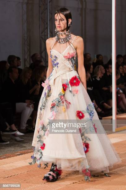 A model walks the runway during the Alexander McQueen Paris show as part of the Paris Fashion Week Womenswear Spring/Summer 2018 on October 2 2017 in...