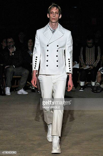 A model walks the runway during the Alexander McQueen Ready to Wear Spring Summer 2016 fashion show during London Menswear Fashion Week on June 14...