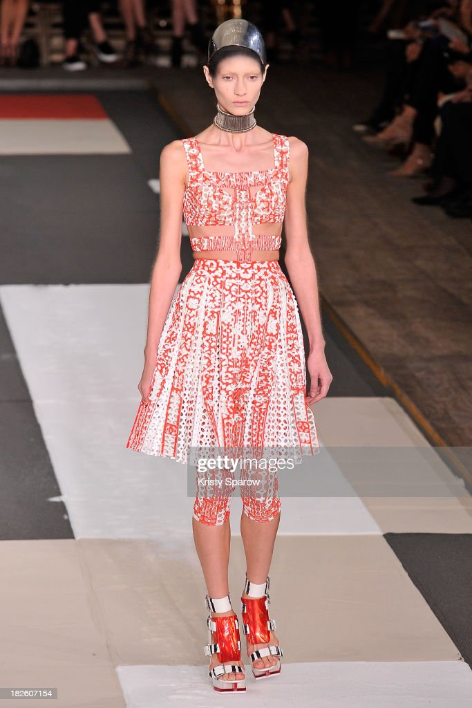 A model walks the runway during the Alexander McQueen show as part of Paris Fashion Week Womenswear Spring/Summer 2014 on October 1, 2013 in Paris, France.