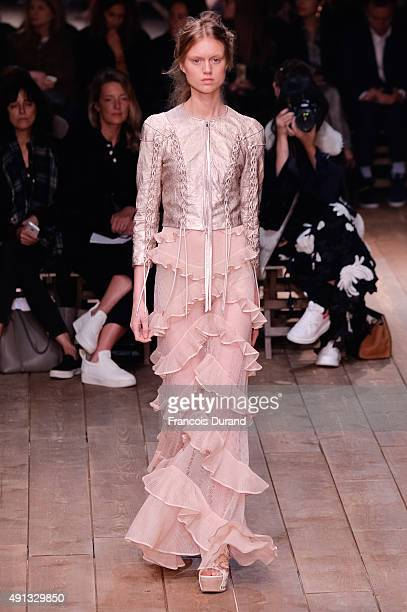 A model walks the runway during the Alexander McQueen show as part of the Paris Fashion Week Womenswear Spring/Summer 2016 on October 4 2015 in Paris...