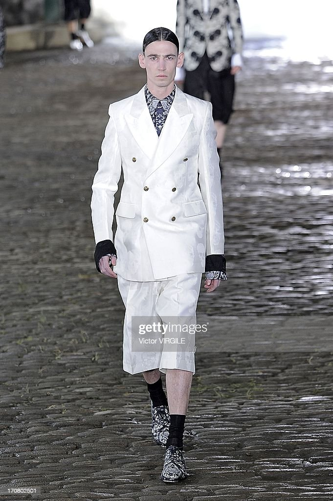A model walks the runway during the Alexander McQueen show during the London Collections: MEN SS14 at The Coal Drops on June 17, 2013 in London, England.