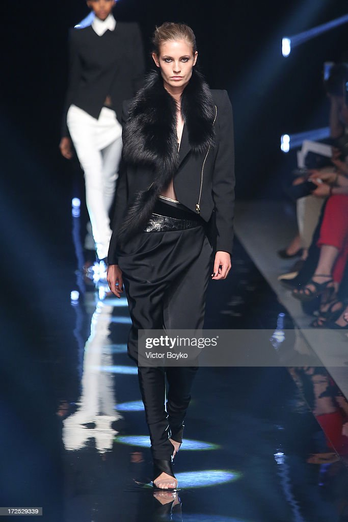 A model walks the runway during the Alexandre Vauthier show as part of Paris Fashion Week Haute-Couture Fall/Winter 2013-2014 at Palais De Tokyo on July 2, 2013 in Paris, France.