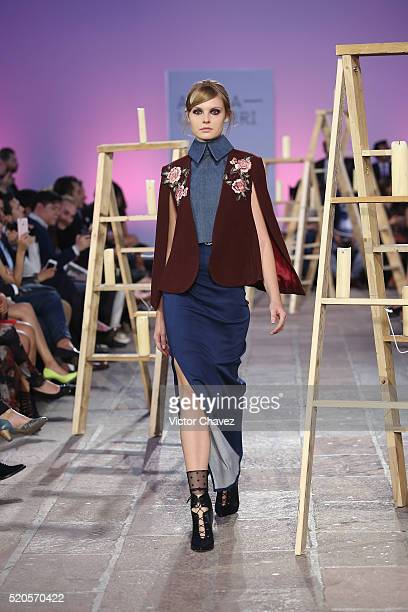 A model walks the runway during the Alexia Ulibarri show at MercedesBenz Fashion Week Mexico Autumn/Winter 2016 at Colegio De Las Vizcainas on April...
