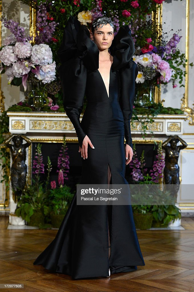 A model walks the runway during the Alexis Mabille show as part of Paris Fashion Week Haute-Couture Fall/Winter 2013-2014 at Hotel dEvreux on July 1, 2013 in Paris, France.