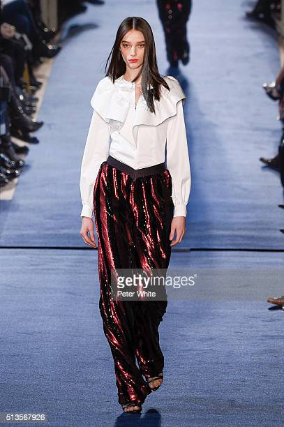 A model walks the runway during the Alexis Mabille show as part of the Paris Fashion Week Womenswear Fall/Winter 2016/2017 on March 3 2016 in Paris...