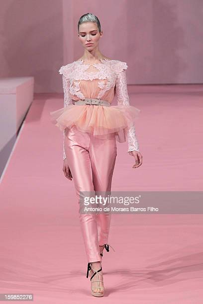 A model walks the runway during the Alexis Mabille Spring/Summer 2013 HauteCouture show as part of Paris Fashion Week at Mairie du 4e on January 21...