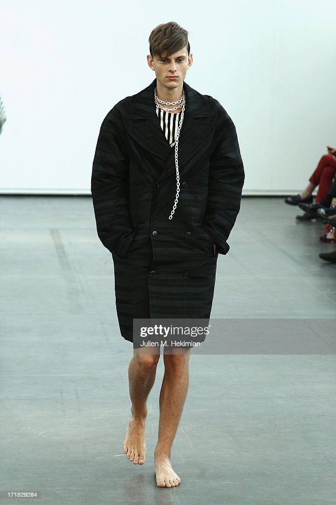 A model walks the runway during the Alibellus + Menswear Spring/Summer 2014 show as part of the Paris Fashion Week on June 26, 2013 in Paris, France.