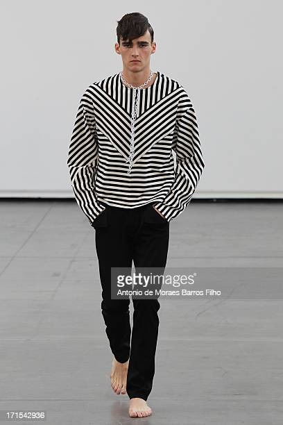 A model walks the runway during the Alibellus Menswear Spring/Summer 2014 Show As Part Of The Paris Fashion Week on June 26 2013 in Paris France