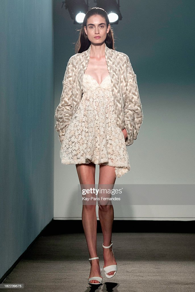 A model walks the runway during the Allude show as part of the Paris Fashion Week Womenswear Spring/Summer 2014 at the Jeu de Paume on September 28, 2013 in Paris, France.