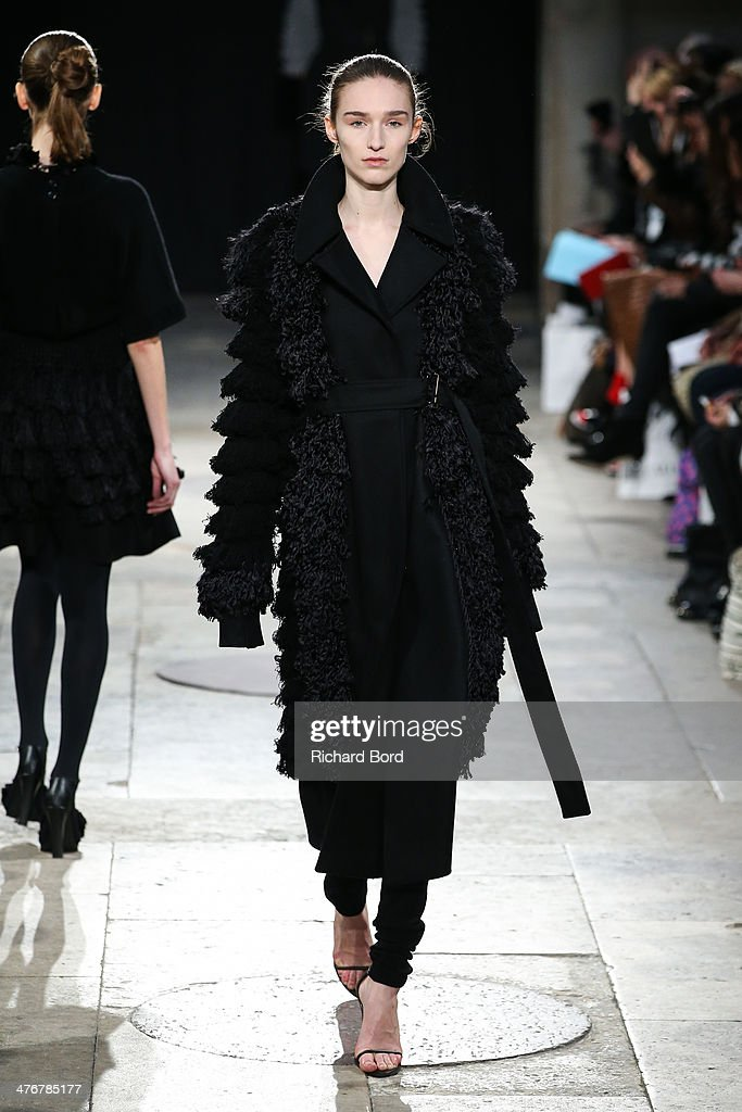 A model walks the runway during the Allude show as part of the Paris Fashion Week Womenswear Fall/Winter 2014-2015 at Chapelle des Beaux Arts on March 5, 2014 in Paris, France.