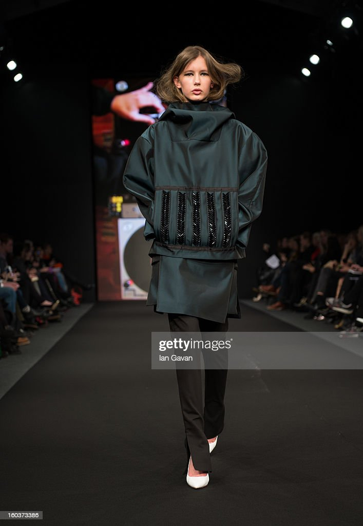 A model walks the runway during the AltewaiSaome show at Mercedes-Benz Stockholm Fashion Week Autumn/Winter 2013 at Mercedes-Benz Fashion Pavilion on January 30, 2013 in Stockholm, Sweden.