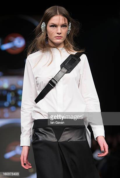 A model walks the runway during the AltewaiSaome show at MercedesBenz Stockholm Fashion Week Autumn/Winter 2013 at MercedesBenz Fashion Pavilion on...