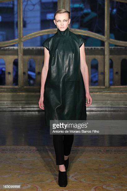 A model walks the runway during the Amaya Arzuaga Fall/Winter 2013 ReadytoWear show as part of Paris Fashion Week on March 4 2013 in Paris France