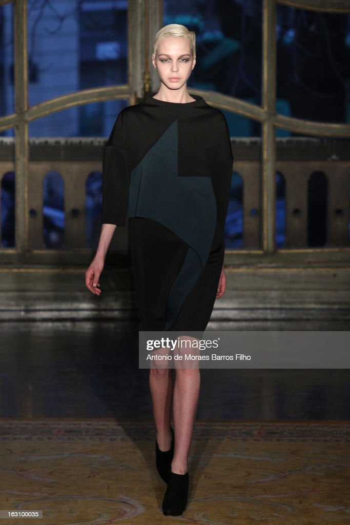 A model walks the runway during the Amaya Arzuaga Fall/Winter 2013 Ready-to-Wear show as part of Paris Fashion Week on March 4, 2013 in Paris, France.