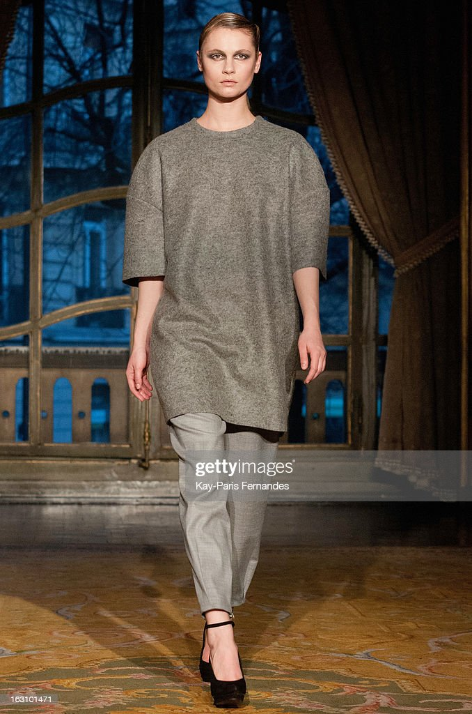 A model walks the runway during the Amaya Arzuaga Fall/Winter 2013 Ready-to-Wear show as part of Paris Fashion Week at the Ambassade D'Espagne on March 4, 2013 in Paris, France.