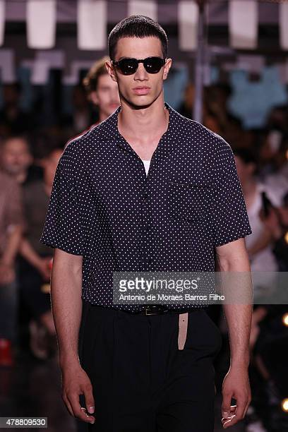 A model walks the runway during the Ami Alexandre Mattiussi Menswear Spring/Summer 2016 show as part of Paris Fashion Week on June 27 2015 in Paris...