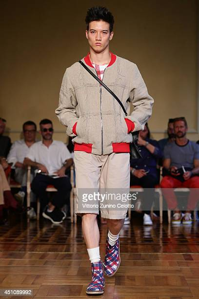 A model walks the runway during the Andrea Incontri show as part of Milan Fashion Week Menswear Spring/Summer 2015 on June 23 2014 in Milan Italy