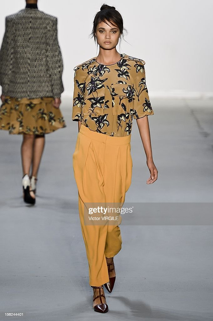 A model walks the runway during the Andrea Marques Fall/Winter 2013 fashion show at Fashion Rio on November 09, 2012 in Rio de Janeiro, Brazil.