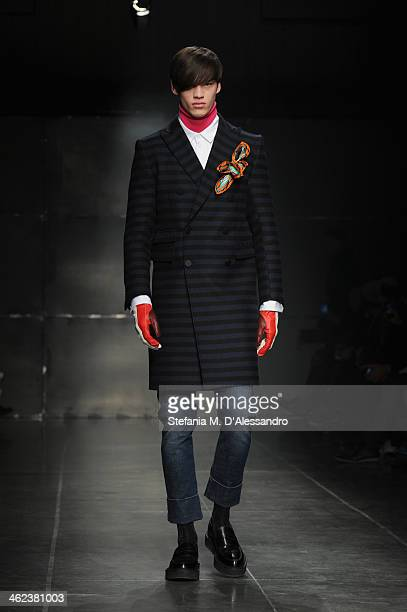 A model walks the runway during the Andrea Pompilio show as a part of Milan Fashion Week Menswear Autumn/Winter 2014 on January 13 2014 in Milan Italy