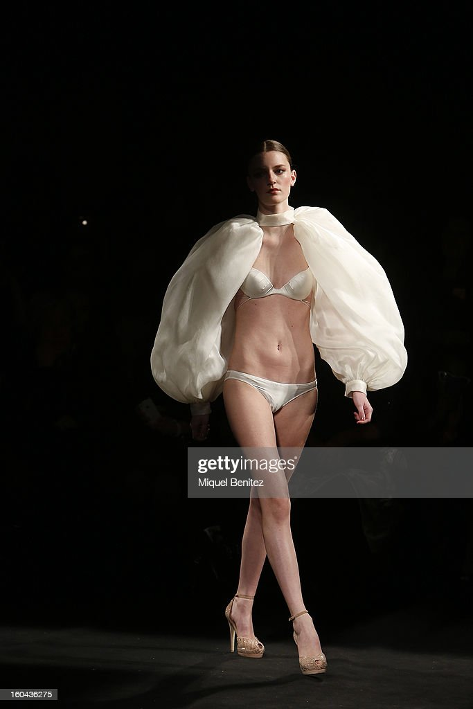 A model walks the runway during the Andres Sarda's Tribute fashion show as part of the 080 Barcelona Fashion Week Autumn/Winter 2013-2014on January 31, 2013 in Barcelona, Spain.