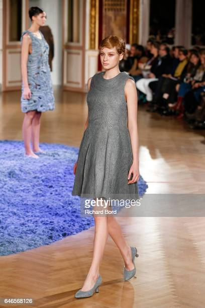 A model walks the runway during the Anrealage show at Westin Hotel as part of the Paris Fashion Week Womenswear Fall/Winter 2017/2018 on February 28...
