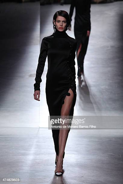 A model walks the runway during the Anthony Vaccarello show as part of the Paris Fashion Week Womenswear Fall/Winter 20142015 on February 25 2014 in...
