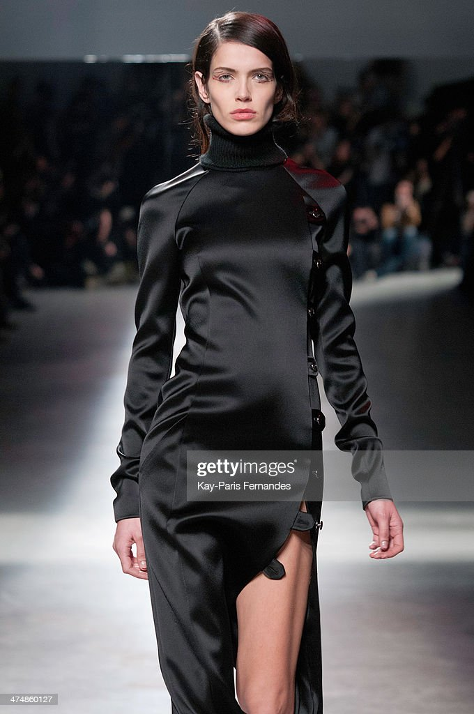 A model walks the runway during the Anthony Vaccarello show as part of the Paris Fashion Week Womenswear Fall/Winter 2014-2015 on February 25, 2014 in Paris, France.