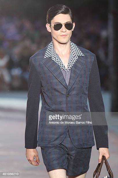 A model walks the runway during the Antonio Marras show as a part of Milan Fashion Week Menswear Spring/Summer 2015 on June 22 2014 in Milan Italy