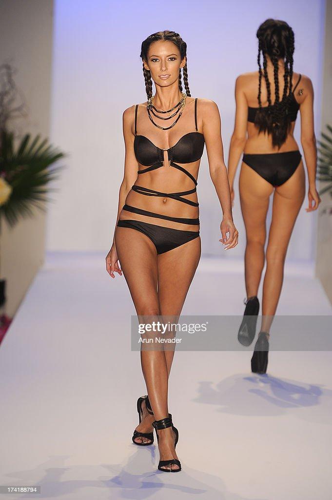 A model walks the runway during the Aqua Di Lara fashion show at Mercedes-Benz Fashion Week Swim 2014 at Raleigh Hotel on July 20, 2013 in Miami Beach, Florida.