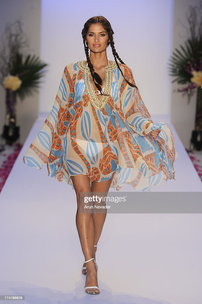A model walks the runway during the Aqua Di Lara fashion show at Mercedes-Benz Fashion Week Swim 2014 at Raleigh Hotel on July 20, 2013 in Miami Beach, Florida.