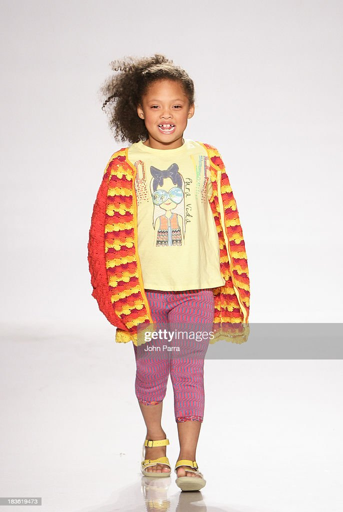 A model walks the runway during the Aracely Santamaria preview at the Parsons The School For Design at petiteParade NY Kids Fashion Week in Collaboration with VOGUEbambini at Industria Superstudio on October 5, 2013 in New York City.