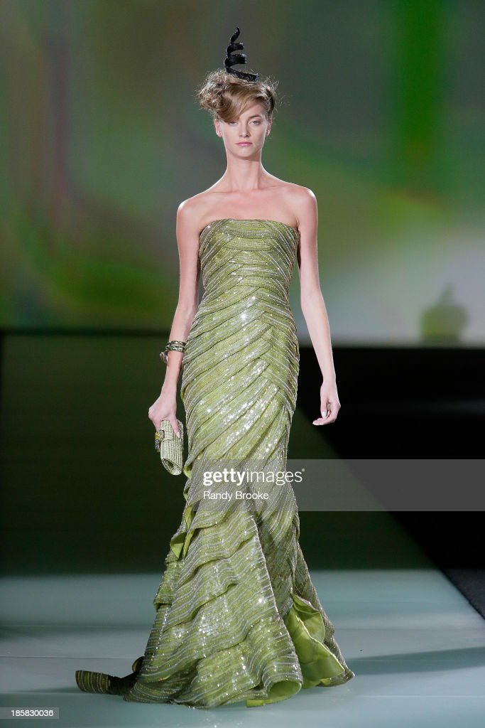 A model walks the runway during the Armani - One Night Only New York at SuperPier on October 24, 2013 in New York City.