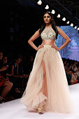 A model walks the runway during the Arpita Mehta show on day 4 of Lakme Fashion Week Summer/Resort 2015 at Palladium Hotel on March 21 2015 in Mumbai...